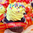 Stock Photo: Birthday cupcake and ribbons