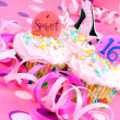 Pink Sweet Sixteen Cupcakes - Stock Photo