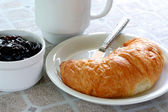 Fresh croissant and jelly — Stock Photo