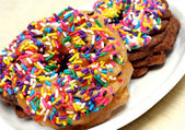 Colorful sprinkled doughnuts. — Stock Photo