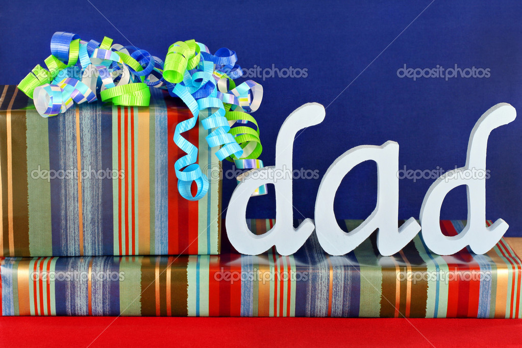 Masculine wrapped gifts with ribbons and the word Dad on top.  Ideal for dad's birthday or father's day. — Stock Photo #3014831