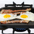 Eggs and Bacon Frying on Cast Iron Pan — Stock Photo