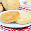 Fresh biscuit with melted butter — Stock Photo