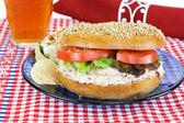 Tuna Salad sandwich on a sesame bagel. — Stock Photo