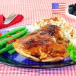 Barbecue chicken dinner decorated with flag. — Stock Photo