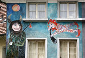 Lucerne, Switzerland, the facade of the house with murals (or graffiti) in — Stock Photo