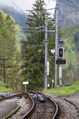 Switzerland, Alps, rails and railway semaphore highlands railroad — Stock Photo