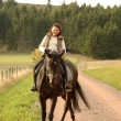 Horsewoman on tittup horse. - Stock Photo