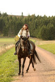 Horsewoman on tittup horse. — Stock Photo