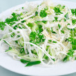 Salad of fresh cabbage and cucumber with herbs and sesame — Stock Photo