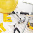 Yellow hardhat on drawings — Stock Photo #2760384