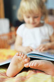 Little girl with book — Foto de Stock