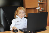 Little girl with laptop — Stok fotoğraf