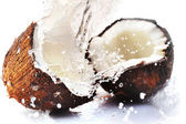 Cracked coconut with splash — Stock Photo