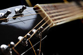 Neck of black guitar — Stock Photo