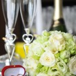 Stock Photo: Candles and wedding bouquet