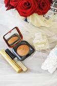 Cosmetics and wedding rings — Stock Photo