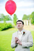 Groom with balloon — Stock Photo
