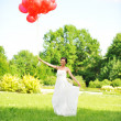 Bride with balloons — Stock Photo #3473086