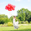 Bride with balloons — Stock Photo #3493228