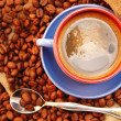 Coffee beans cup with coffee and spoon - Stock Photo
