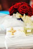 Perfume and wedding rings — Stock Photo