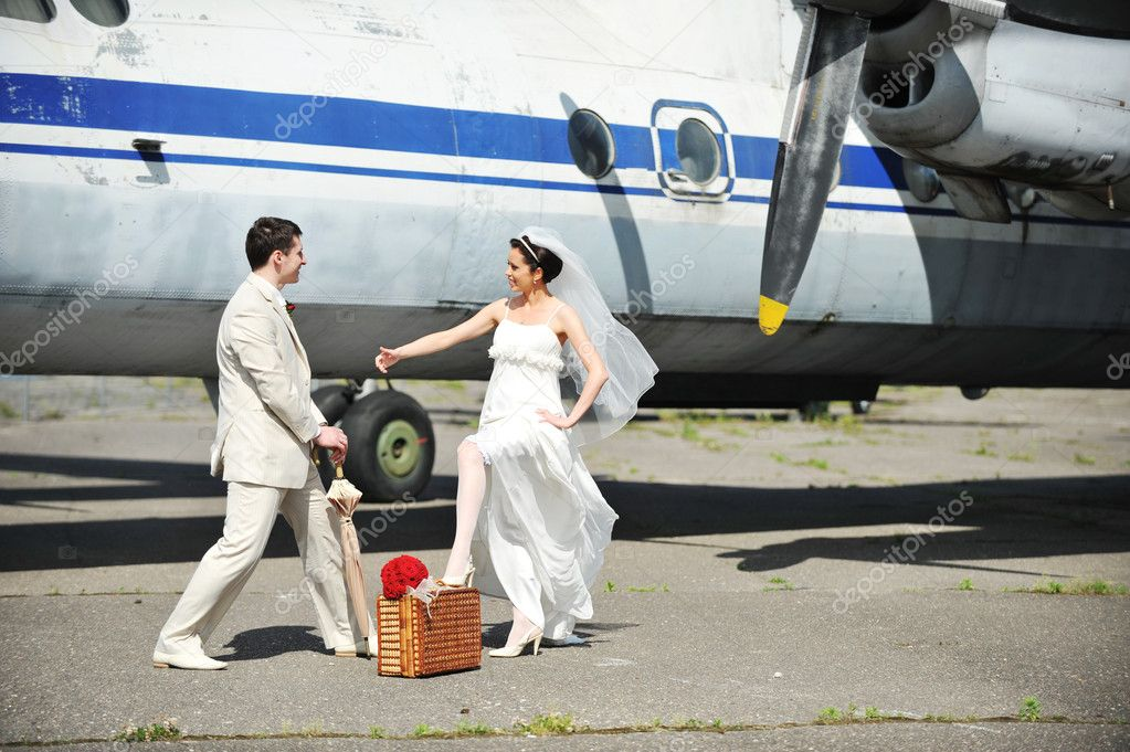 Groom and bride fly to wedding travel by  plane — Stock Photo #3522058