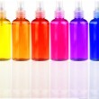 Colored bottles with cosmetics in a row — Stock Photo