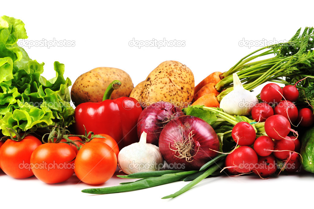 Fresh vegetables. Included are  tomatoes, carrots,radish, cucumber,  potato, onions and garlic  Stock Photo #3707513