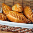 Pies in  basket — Stock Photo