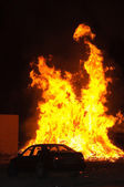 Car and fire — Stock Photo