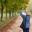 Woman in autumn park - 