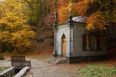 Chapel in autumn forest — Stock Photo