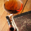 Stock Photo: Old books and cognac