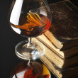 Glass of cognac and books — Stock Photo