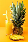 Pineapple and juice — Stock Photo