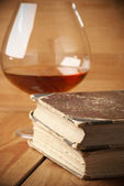 Old books and cognac — Stock Photo