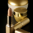 Golden cosmetics — Stock Photo