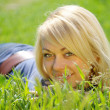 Blond woman in grass — Stock Photo
