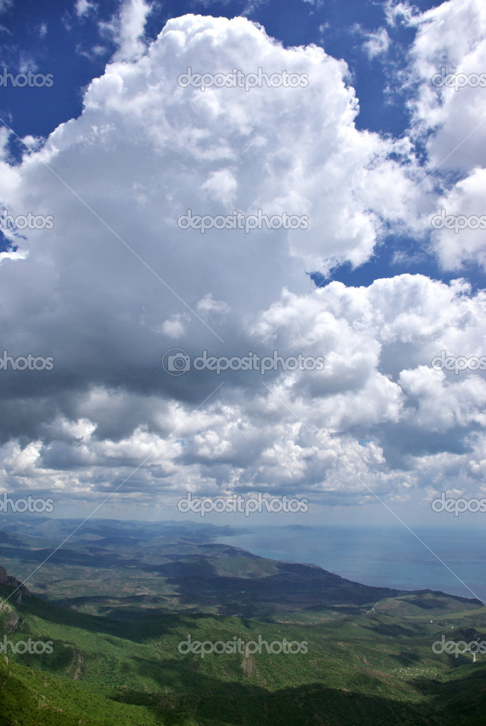 Cumulus clouds above hilly coast. — Stock Photo #2766586