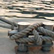 Bitts with rope - Stock Photo