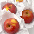 Apples in paper - Stock Photo