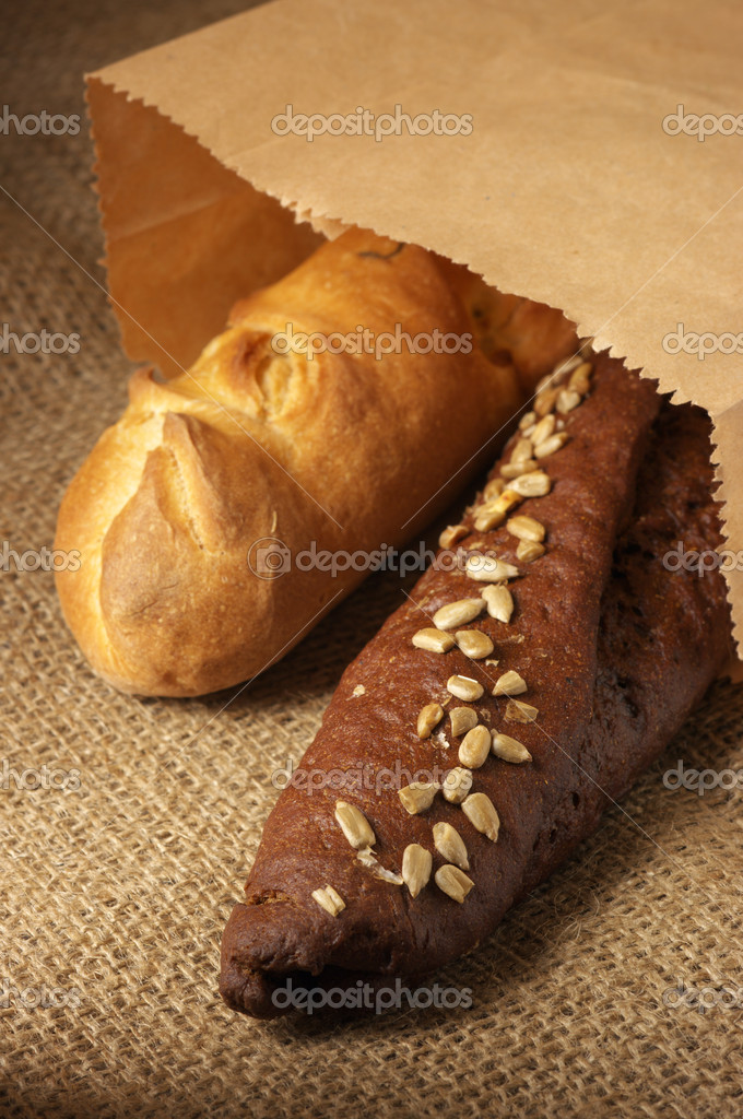 Rye and wheat bread in paper bag on sack. — Stock Photo #2785956