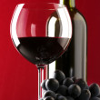 Stock Photo: Red wine and grape