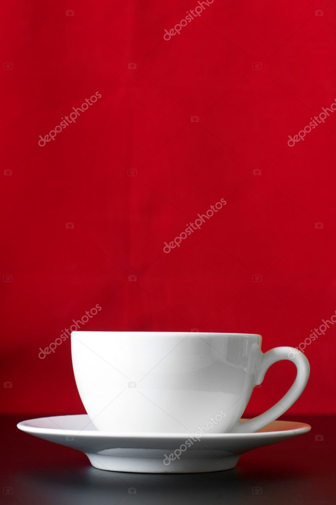 White cup of coffee on red/black background. — Stock Photo #2822305