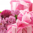 Pink gifts and chryzanthemiums - Stock Photo