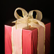 Red foil gift - Stock Photo
