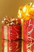 Red/gold gifts — Stock Photo