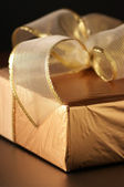Golden gift close-up — Stock Photo