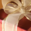 Red/gold gift close-up — Stock Photo